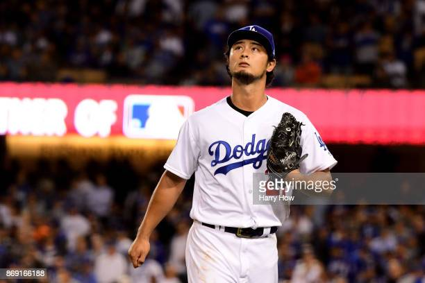 Yu Darvish of the Los Angeles Dodgers walks to the dugout after being relieved during the second inning against the Houston Astros in game seven of...