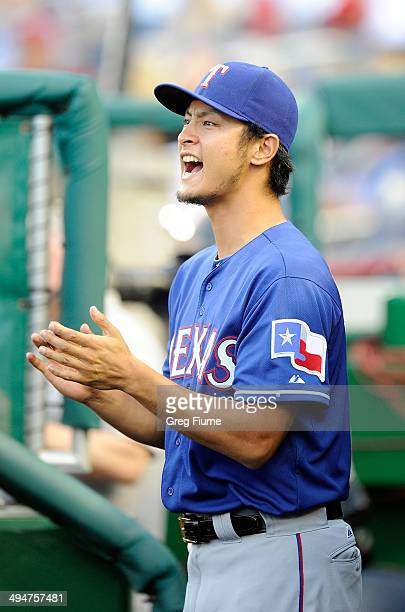 Yu Darvish of the Texas Rangers celebrates as Texas scores in the second inning against the Washington Nationals at Nationals Park on May 30 2014 in...