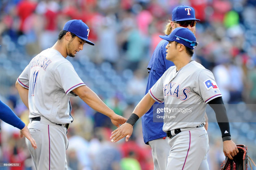 Yu Darvish #11 of the Texas Rangers celebrates with Shin-Soo Choo #17 after a 5-1 victory against the Washington Nationals at Nationals Park on June 11, 2017 in Washington, DC.