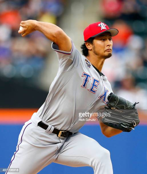 Yu Darvish of the Texas Rangers delivers a pitch during the first inning against the New York Mets on July 4 2014 at Citi Field in the Flushing...