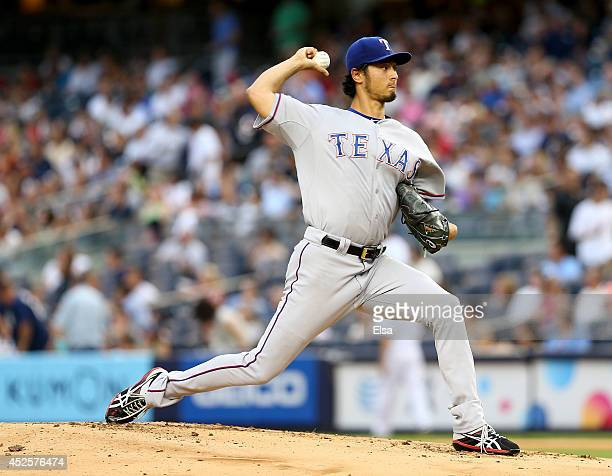 Yu Darvish of the Texas Rangers delivers a pitch in the first inning against the New York Yankees on July 23 2014 at Yankee Stadium in the Bronx...