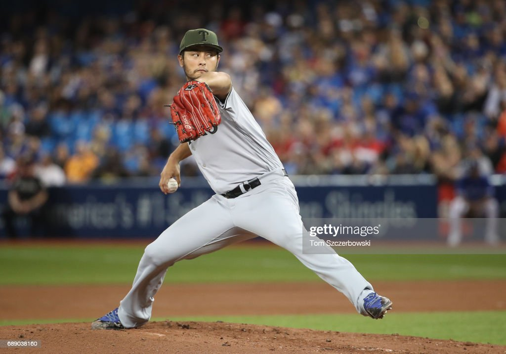 Yu Darvish #11 of the Texas Rangers delivers a pitch in the first inning during MLB game action against the Toronto Blue Jays at Rogers Centre on May 27, 2017 in Toronto, Canada.