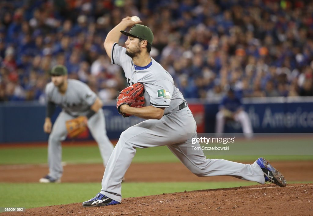 Yu Darvish #11 of the Texas Rangers delivers a pitch in the third inning during MLB game action against the Toronto Blue Jays at Rogers Centre on May 27, 2017 in Toronto, Canada.