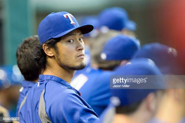 Yu Darvish of the Texas Rangers listens to a teammate while in the dugout during the fourth inning against the Cleveland Indians at Progressive Field...