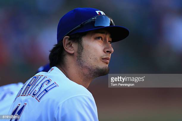 Yu Darvish of the Texas Rangers looks on from the dugout as the Rangers take on the Seattle Mariners in the top of the eighth inning on Opening Day...