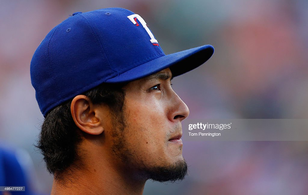 Yu Darvish #11 of the Texas Rangers looks on from the dugout as the Texas Rangers take on the Baltimore Orioles in the bottom of the second inning at Globe Life Park in Arlington on June 3, 2014 in Arlington, Texas.