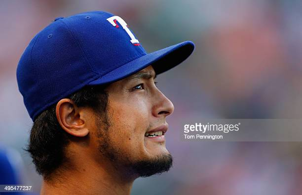 Yu Darvish of the Texas Rangers looks on from the dugout as the Texas Rangers take on the Baltimore Orioles in the bottom of the second inning at...