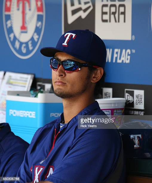 Yu Darvish of the Texas Rangers looks on from the dugout before the start of the game against the Cleveland Indians at Globe Life Park in Arlington...