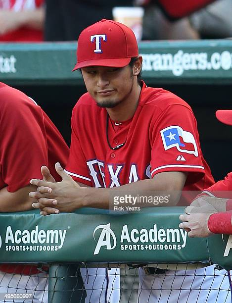 Yu Darvish of the Texas Rangers looks on from the dugout during the game against the Baltimore Orioles at Globe Life Park in Arlington on June 4 2014...
