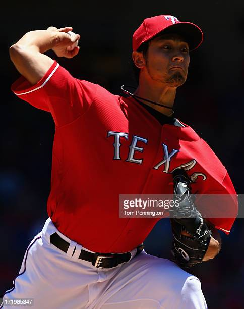 Yu Darvish of the Texas Rangers pitches againnst the Cincinnati Reds in the top outfield the first inning at Rangers Ballpark in Arlington on June...