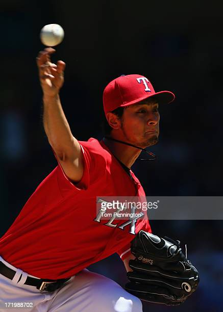 Yu Darvish of the Texas Rangers pitches against the Cincinnati Reds in the top of the third inning at Rangers Ballpark in Arlington on June 30, 2013...
