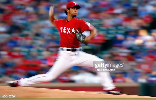 Yu Darvish of the Texas Rangers pitches against the Miami Marlins in the top of the first inning at Globe Life Park in Arlington on June 11 2014 in...