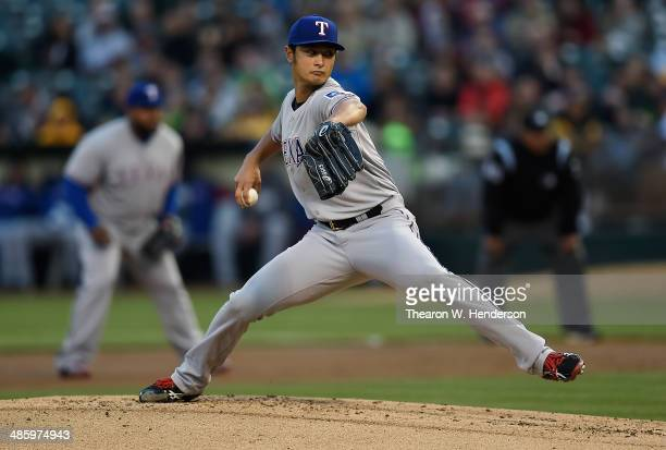 Yu Darvish of the Texas Rangers pitches against the Oakland Athletics in the bottom of the first inning at Oco Coliseum on April 21 2014 in Oakland...
