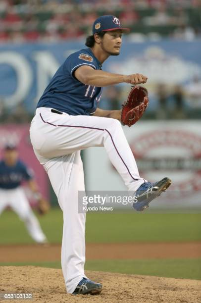 Yu Darvish of the Texas Rangers pitches against the San Francisco Giants in a spring training game in Surprise Arizona on March 13 2017 Darvish...