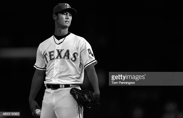 Yu Darvish of the Texas Rangers pitches against the Seattle Mariners in the top of the first inning at Globe Life Park in Arlington on April 16 2014...