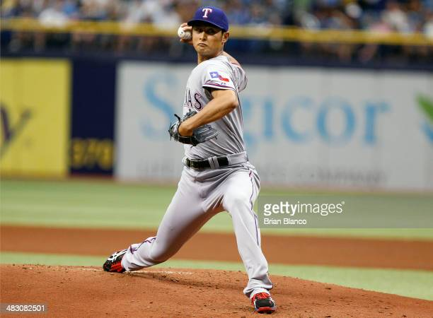 Yu Darvish of the Texas Rangers pitches during the first inning of a game against the Tampa Bay Rays on April 6 2014 at Tropicana Field in St...
