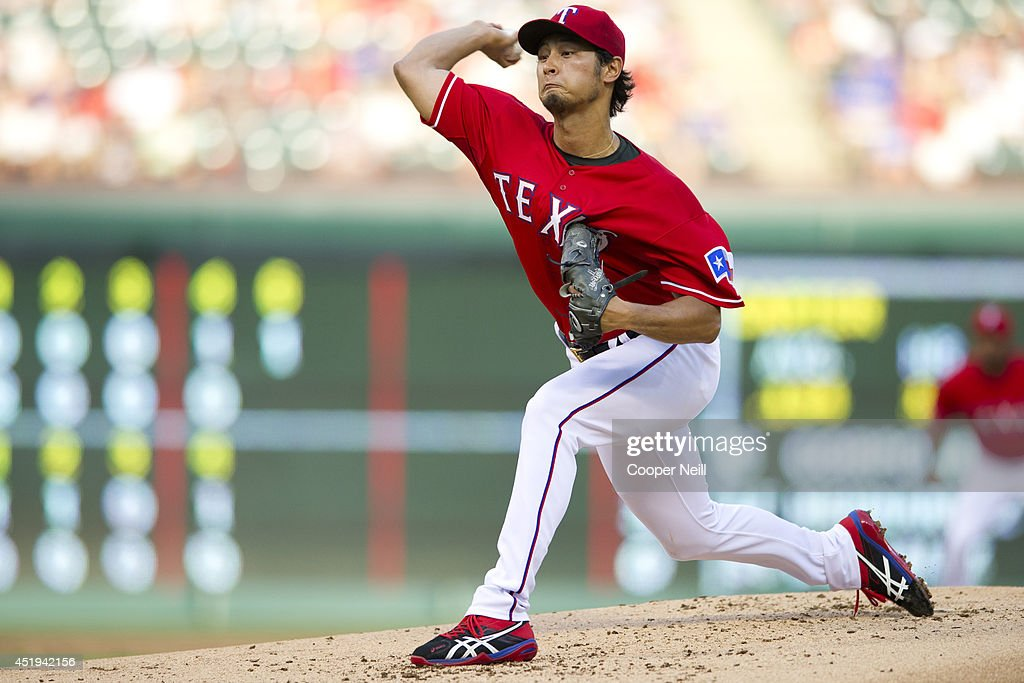 Yu Darvish #11 of the Texas Rangers pitches during the second inning against the Houston Astros on July 9, 2014 at Globe Life Park in Arlington in Arlington, Texas.