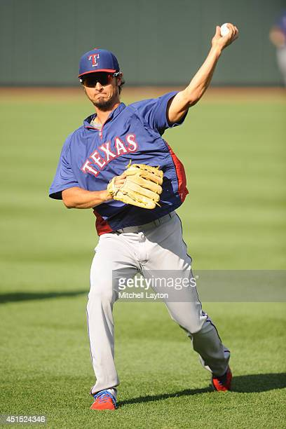 Yu Darvish of the Texas Rangers practices throwing left handed during batting practice before a baseball game against the Baltimore Orioles on June...