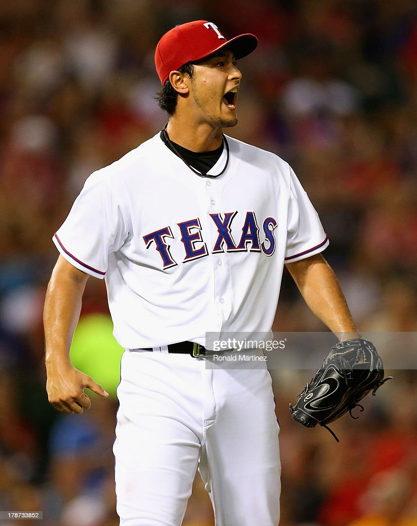 Yu Darvish #11 of the Texas Rangers reacts after making the final out of the sixth inning against the Minnesota Twins at Rangers Ballpark in Arlington on August 30, 2013 in Arlington, Texas.