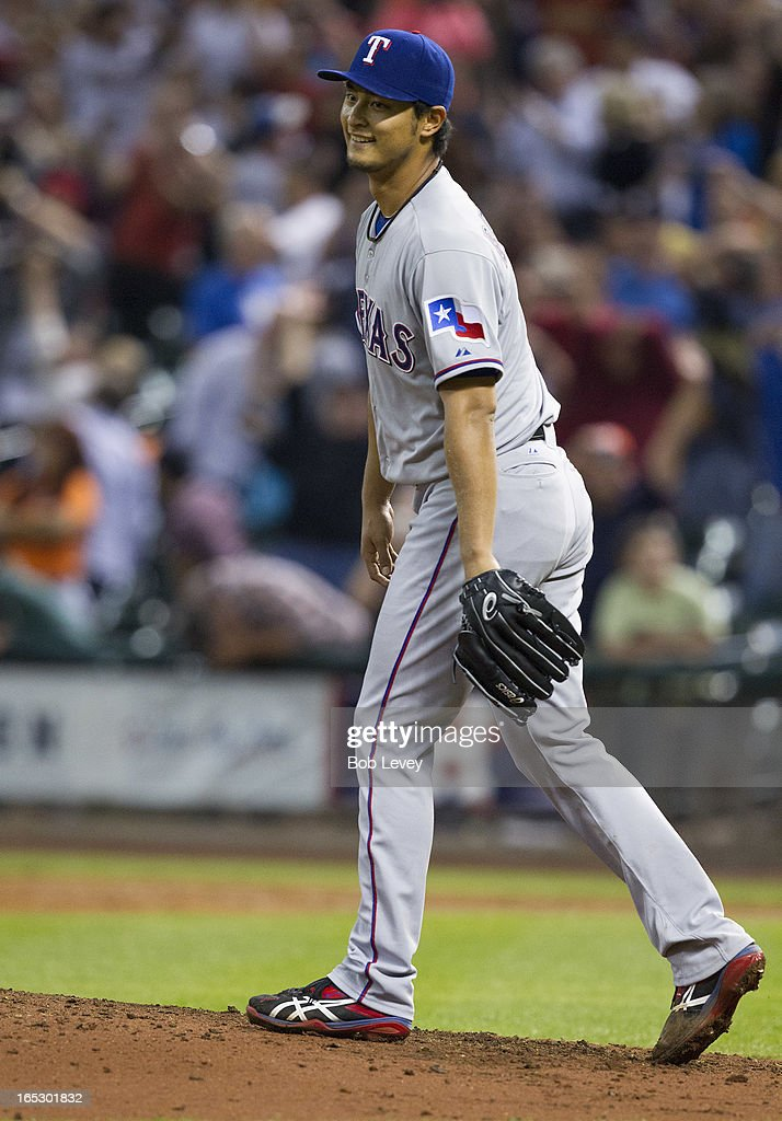 Yu Darvish #11 of the Texas Rangers reacts after not being able to field a line drive back through his legs in the ninth inning by Marwin Gonzalez #9 of the Houston Astros (not pictured) to break up a perfect game at Minute Maid Park on April 2, 2013 in Houston, Texas.