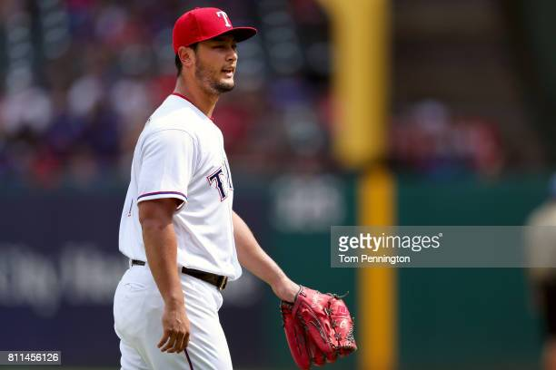 Yu Darvish of the Texas Rangers reacts while being pulled from the game against the Los Angeles Angels in the top of the eighth inning at Globe Life...