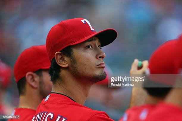 Yu Darvish of the Texas Rangers sits in the dugout during a game against the Boston Red Sox at Globe Life Park in Arlington on May 10 2014 in...