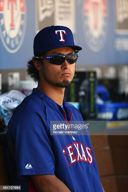 Yu Darvish of the Texas Rangers sits in the dugout during play against the Kansas City Royals at Globe Life Park in Arlington on August 24 2014 in...