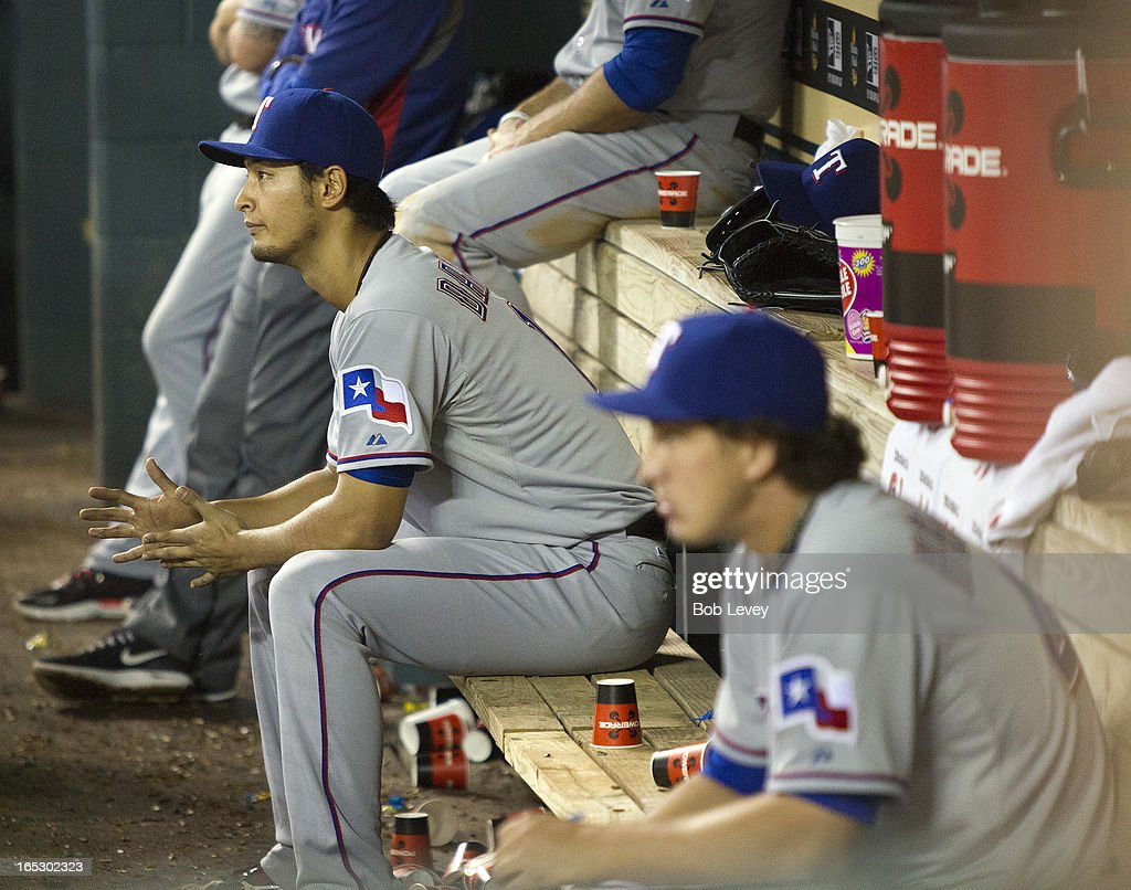 Yu Darvish #11 of the Texas Rangers sits on bench after he was taken out of the game after throwing a near perfect game against the Houston Astros at Minute Maid Park on April 2, 2013 in Houston, Texas.
