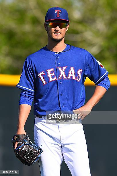 Yu Darvish of the Texas Rangers smiles as he works out during the spring training at the Surprise Stadium on March 8 2015 in Surprise Arizona
