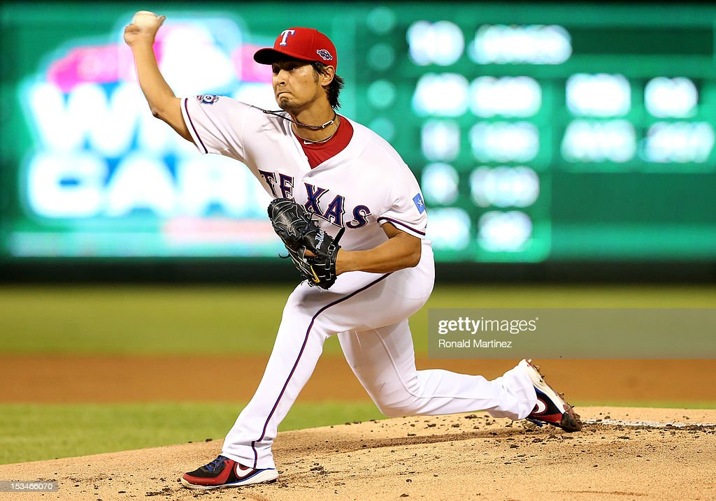 Yu Darvish #11 of the Texas Rangers throws a pitch against the Baltimore Orioles during the American League Wild Card playoff game at Rangers Ballpark in Arlington on October 5, 2012 in Arlington, Texas.