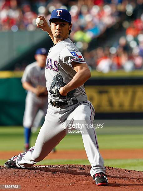 Yu Darvish of the Texas Rangers throws against the Houston Astros in the first inning at Minute Maid Park on May 11 2013 in Houston Texas