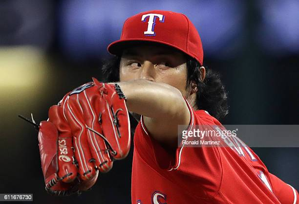 Yu Darvish of the Texas Rangers throws against the Tampa Bay Rays in the first inning at Globe Life Park in Arlington on September 30 2016 in...