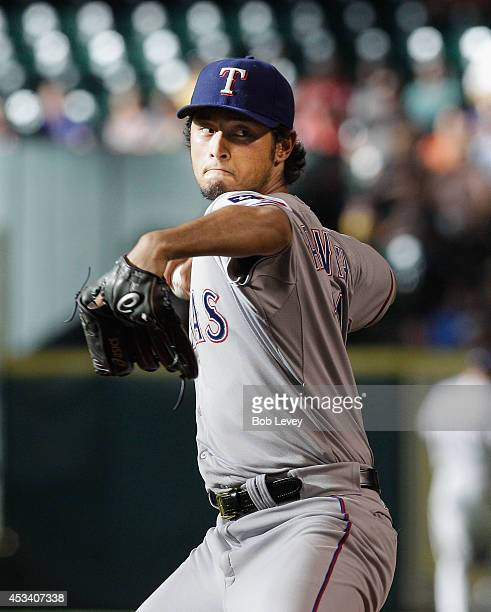 Yu Darvish of the Texas Rangers throws in the first inning against the Houston Astros at Minute Maid Park on August 9 2014 in Houston Texas