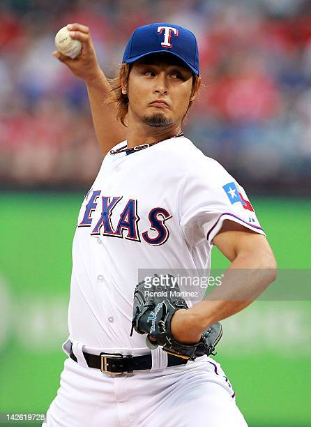Yu Darvish of the Texas Rangers throws out the first pitch against Chone Figgins of the Seattle Mariners in the first inning at Rangers Ballpark in...