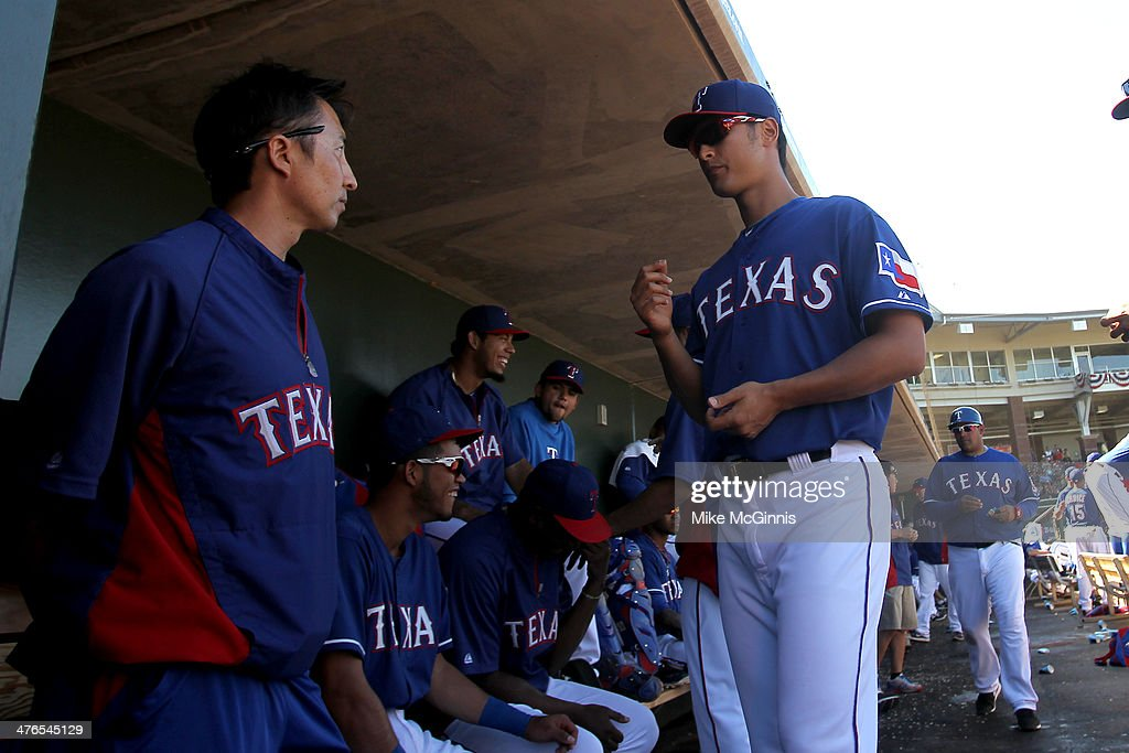 Yu Darvish #11 of the Texas Rangers walks the dugout during the top of the fourth inning against the Cleveland Indians at Surprise Stadium on March 03, 2014 in Surprise, Arizona.
