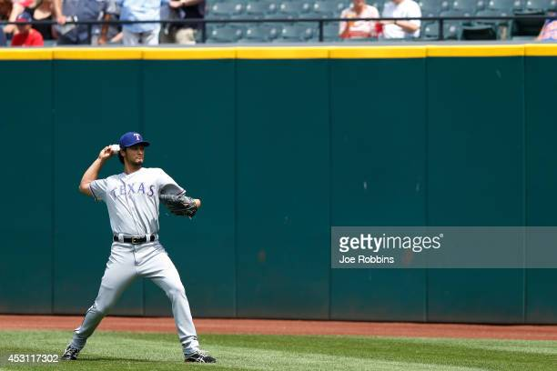 Yu Darvish of the Texas Rangers warms up before the game against the Cleveland Indians at Progressive Field on August 3 2014 in Cleveland Ohio