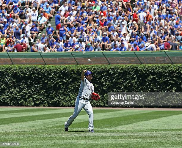 Yu Darvish of the Texas Rangers warms up in the outfield before pitching against the Chicago Cubs at Wrigley Field on July 16 2016 in Chicago Illinois