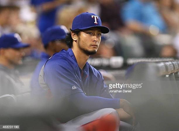 Yu Darvish of the Texas Rangers watches a game against the Chicago White Sox from the dugout at US Cellular Field on August 5 2014 in Chicago Illinois