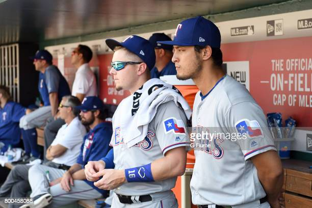 Yu Darvish of the Texas Rangers watches the game with teammates during the first inning of the game against the Washington Nationals at Nationals...