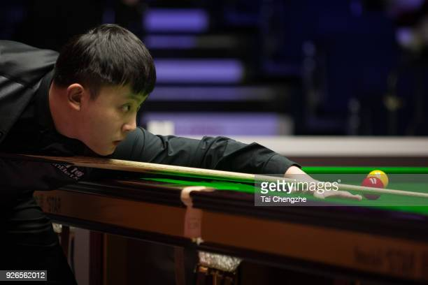 Yu Delu of China plays a shot during his quarterfinal match against Gary Wilson of England on day five of 2018 ManBetX Welsh Open at Motorpoint Arena...