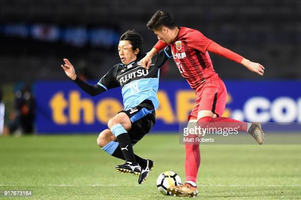 Yu Hai of Shanghai SIPG and Kengo Nakamura of Kawasaki Frontale compete for the ball during the AFC Champions League Group F match between Kawasaki...