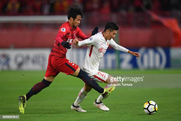 Yu Hai of Shanghai SIPG and Tomoya Inukai of Kashima Antlers compete for the ball during the AFC Champions League Round of 16 first leg match between...