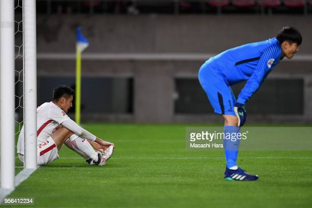 Yu Hai of Shanghai SIPG shows dejection after his own goal during the AFC Champions League Round of 16 first leg match between Kashima Antlers and...