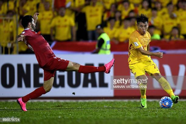 Yu Hanchao of China vies for the ball with Zaher Almedani of Syria during the FIFA World Cup 2018 Group A third round qualifying match between Syria...