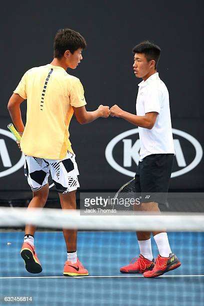 Yu Hsiou Hsu of Taipei and Lingxi Zhao of China compete in their first round match against Alberto Lim of the Philippinnes and Alexandre Rotsaert of...