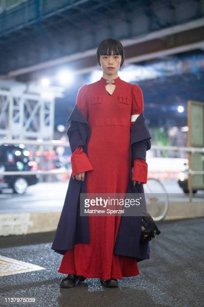 Yu Ishizuka is seen wearing red dress with navy coat during the Amazon Fashion Week TOKYO 2019 A/W on March 23 2019 in Tokyo Japan