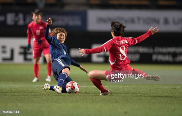 Yu Jong Im of DPR Korea and Sakaguchi Mizuho of Japan in action during the EAFF E1 Women's Football Championship between Japan and North Korea at...