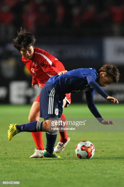 Yu Jong Im of North Korea and Mina Tanaka of Japan compete for the ball during the EAFF E1 Women's Football Championship between Japan and North...