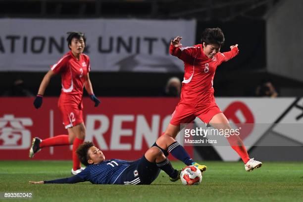 Yu Jong Im of North Korea is tackled by Mina Tanaka of Japan during the EAFF E1 Women's Football Championship between Japan and North Korea at Fukuda...