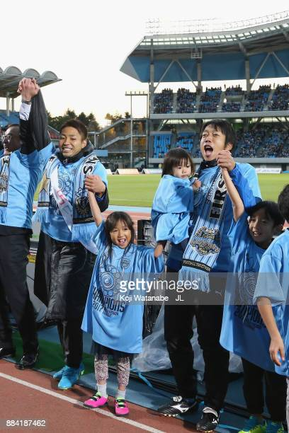 Yu Kobayashi and Kengo Nakamura of Kawasaki Frontale celebrate their JLeague Champions with their children after the JLeague J1 match between...